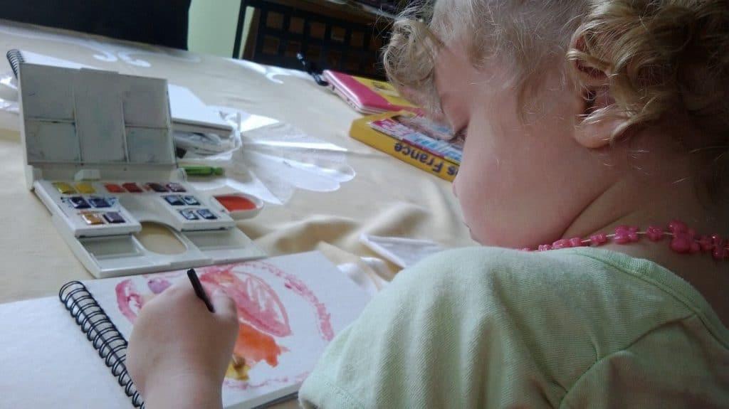 creative kid making an art